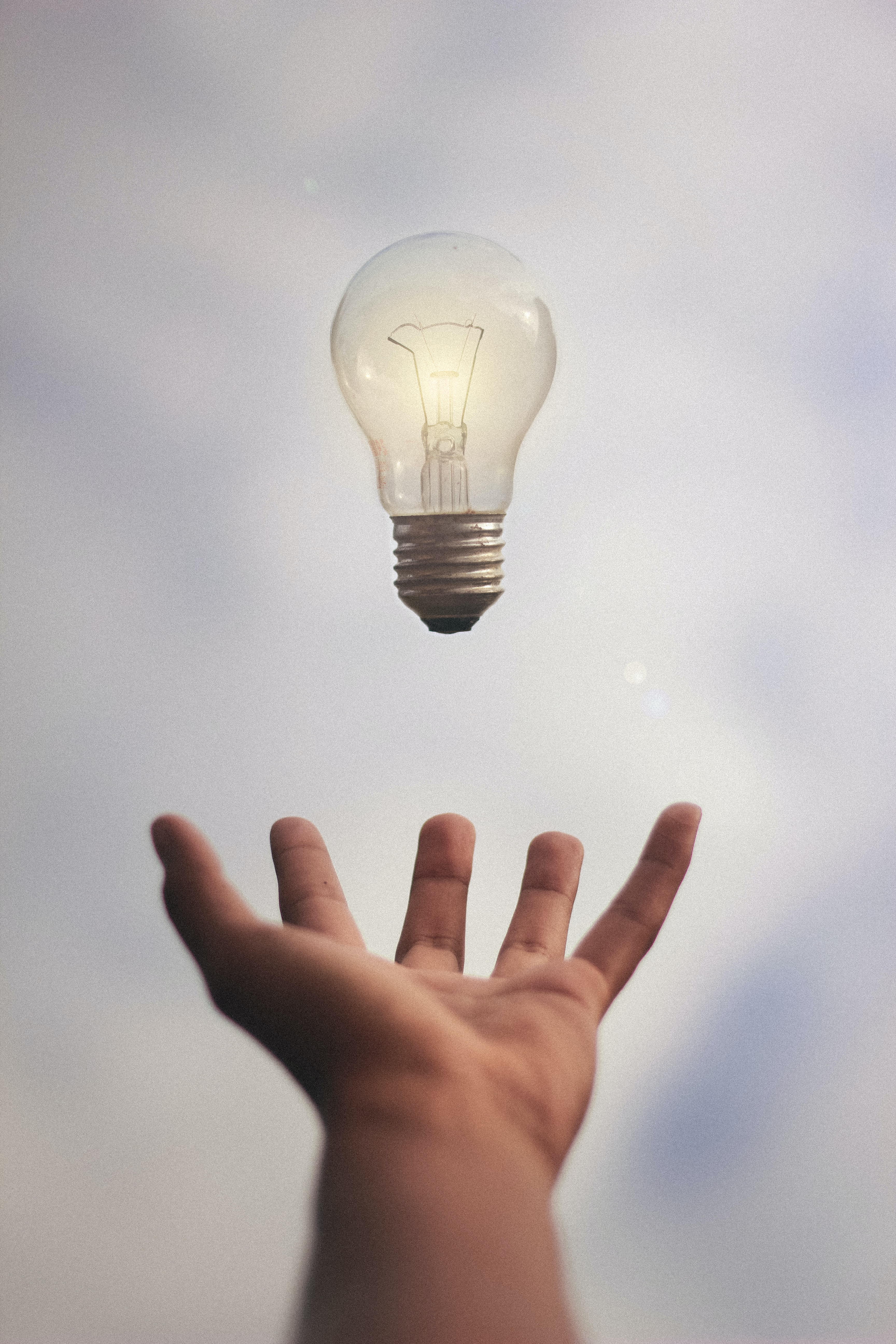 reaching for lightbulb showing value to losing clients